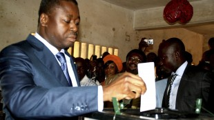 President of Togo Gnassingbe casts his ballot inside a school in Lome